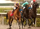 Kettle Corn (left) goes by Paynter (center) to win the San Diego Handicap.