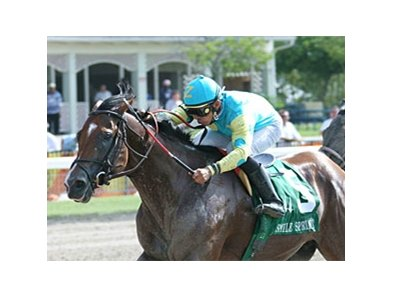 Eaton's Gift and Jose Lezcano take the Smile Stakes at Calder.