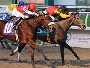 My Jen with Jamie Theriot up dukes it out with Visavis and jockey Brian Hernandez, Jr. to win the 51st running of the Letellier Memorial Stakes at Fair Grounds.