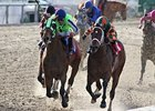 Infrattini (left) fights off Mark Valeski to win the Louisiana Handicap.