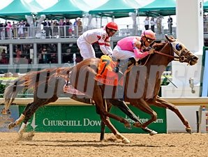 Blind Luck wins the 2011 La Troienne.