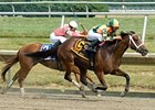 Proud Spell pulls away in the Delaware Oaks.
