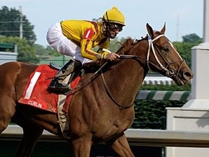 Curlin glides under the wire an easy victor in the June 14 Stephen Foster (gr. I) at Churchill Downs.
