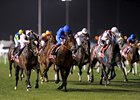 Wigmore Hall (left, pink and black cap) captures the Jebel Hatta at Meydan.