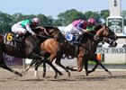 "Favored Porte Bonheur holds on to win the First Flight Handicap at Belmont Park.<br><a target=""blank"" href=""http://www.bloodhorse.com/horse-racing/photo-store?ref=http%3A%2F%2Fpictopia.com%2Fperl%2Fgal%3Fprovider_id%3D368%26ptp_photo_id%3D8280590%26ref%3Dstory"">Order This Photo</a>"
