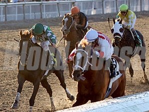 Euroears with Jamie Theriot up pulls ahead of Tempo Five with James Graham aboard to win the Thanksgiving Day Handicap at Fair Grounds.