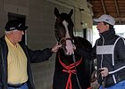 Ronnie Lamarque (left) and Louie Roussel III with Recapturetheglory at Churchill Downs.