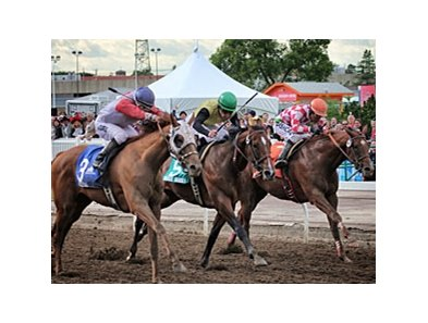 Toccetive (left) rolls late to win the Canadian Derby.