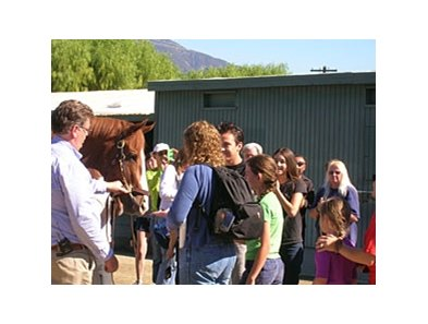 Shackleford (with trainer Dale Romans, left) greets his fans at Santa Anita.
