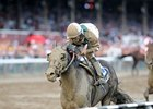 "Street Life sails through the mud to win the Curlin.<br><a target=""blank"" href=""http://photos.bloodhorse.com/AtTheRaces-1/at-the-races-2012/22274956_jFd5jM#!i=1991175876&k=6FVmPTC"">Order This Photo</a>"