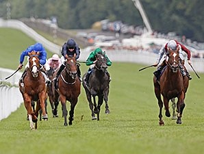 Toronado, outside in gray silks, wins the Sussex Stakes at Goodwood.