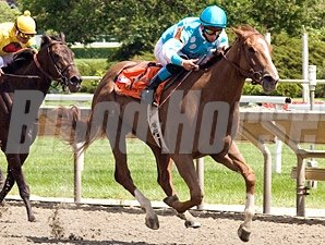 Apple Martini takes the Purple Violet, the first of 2 wins for trainer Chris Block in the Prairie State Festival at Arlington.