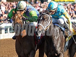 Courageous Julie (right) and Henny Jenney deadheat in an allowance on October 24, 2014.