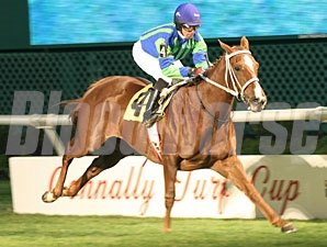 Love to Tell wins the 2010 Jersey Lilly Stakes.