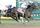 Neck 'n Neck surges late to win the Indiana Derby.