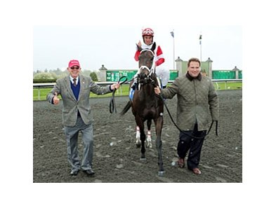 Trainer Mike Maker (right) and owner Ken Ramsey (left) with Bernie the Maestro (Joel Rosario aboard), Maker's 17th winner of the meet.