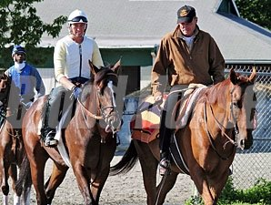 Tale Of Ekati heads to the Belmont Park main track escorted by 2003 Kentucky Derby winner Funny Cide.