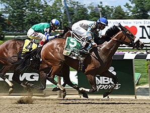 Sweet Reason wins the 2014 TVG Acorn Stakes.