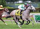 "Winter Memories rolls late to win the Garden City Stakes at Belmont.<br><a target=""blank"" href=""http://www.bloodhorse.com/horse-racing/photo-store?ref=http%3A%2F%2Fpictopia.com%2Fperl%2Fgal%3Fprovider_id%3D368%26ptp_photo_id%3D9670875%26ref%3Dstory"">Order This Photo</a>"