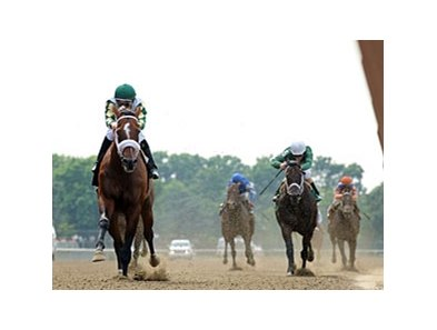 "Mucho Macho Man leaves the rest behind in the Suburban Handicap.<br><a target=""blank"" href=""http://photos.bloodhorse.com/AtTheRaces-1/at-the-races-2012/22274956_jFd5jM#!i=1951069762&k=grg26cH"">Order This Photo</a>"
