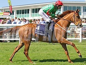 Dancing Rain wins the Investec Oaks.