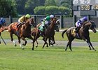 Curlin (yellow silks) finishes second to Red Rocks in the July 12 Man o'War (gr. IT) at Belmont Park.