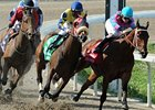 Daisy Devine (center, Blue & Yellow silks) begins the winning move in the Fair Ground Oaks.