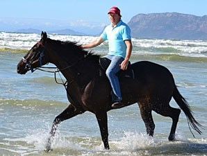 Ebony Flyer and trainer Justin Snaith at the beach in Cape Town.