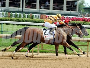 Successful Dan (left) overtakes Fort Larned to win the 2012 Alysheba.