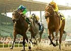 Tiz Elemental (right) wins the Las Flores Handicap(gr. III) April 6 at Santa Anita, her fourth consecutive victory.