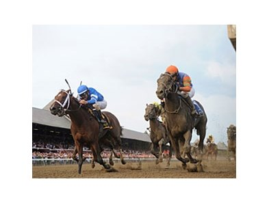 Golden Ticket, right, in the Travers dead heat with Alpha.
