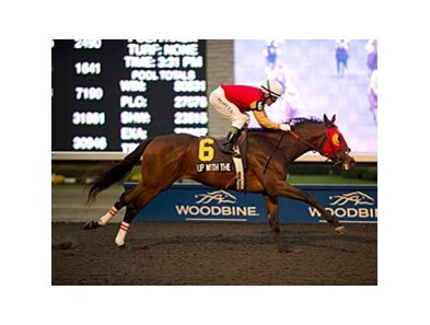 Up With the Birds rolls to the win in the Coronation Futurity at Woodbine.