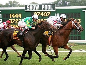 Big Brown Holds Off Proudinsky On Turf