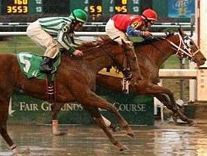 Anything But Quiet with Billy Patin up prevails over Yare with Shane Sellers aboard to win the 2010 Happy Ticket Stakes.