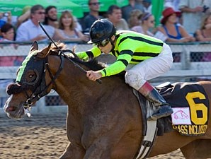 Class Included wins the 2011 BC Oaks.