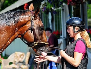 Exercise rider Michelle Nevin gets a friendly kiss from Big Brown.