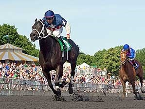 Fire Tricks wins the 2014 Isaac Murphy Handicap (via DQ).