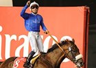 Mickael Barzalona celebrates victory in the Dubai World Cup aboard Monterosso.