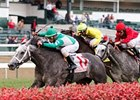 Yankee Fourtune and Victor Santiago score in the Commonwealth Turf.