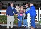 The connections of King Henny accepting the winning trophy.