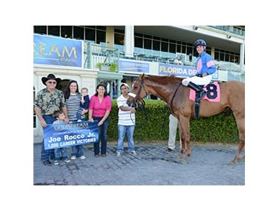 Jockey Joe Rocco Jr. celebrates win number 1,000.
