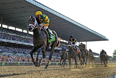 Jockey Mike Smith guides Palace Malice to the win in the 145th running of The Belmont Stakes at Belmont Park in Elmont, N.Y.