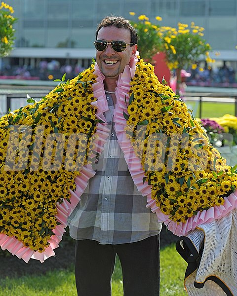 Caption: Groom Jorgie Alvarez with the Black-Eyed Susan blanket.