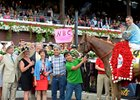 V. E. Day won the 2014 Travers Stakes