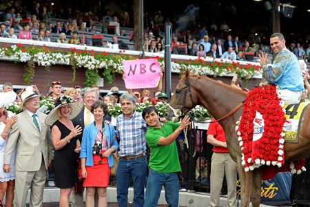 Connections celebrate after V.E. Day and jockey Javier Castellano's win in the Travers Stakes.