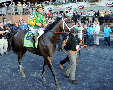 Palace Malice and Mike Smith are circled in the Belmont Park winner's circle.