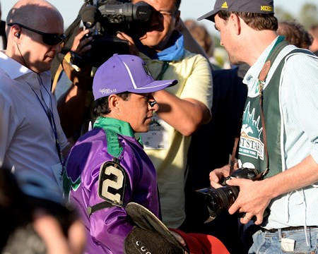 Victor Espinoza walks off the track following California Chrome's third place finish.