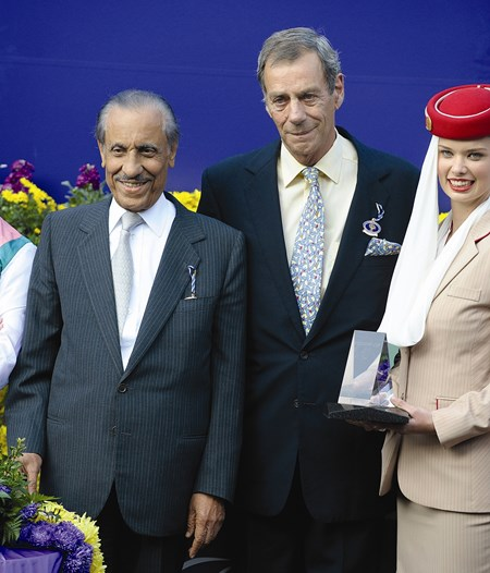 Owner Prince Khaled Abdullah and trainer Sir Henry Cecil. Midday, with Thomas Queally, wins the Emirates Airline Breeders' Cup Filly and Mare Turf in 2009.