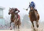 Gold Medal Dancer (right) holds off Untapable to win the Azeri at Oaklawn Park.
