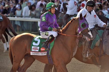 Victor Espinoza aboard California Chrome in the Post Parade before the 140th Kentucky Derby.